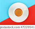 Full white espresso coffee cup on red and blue 47220541