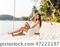 Sensual tender girl sitting on a swing wearing 47222197