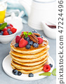 Stack of fluffy pancakes with fresh berries 47224496