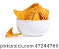 Corn chips in white bowl 47244760
