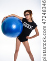 Studio shot of young Asian geek girl holding gym ball while wear 47248346