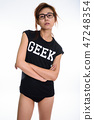 Studio shot of young Asian geek girl wearing eyeglasses with arm 47248354
