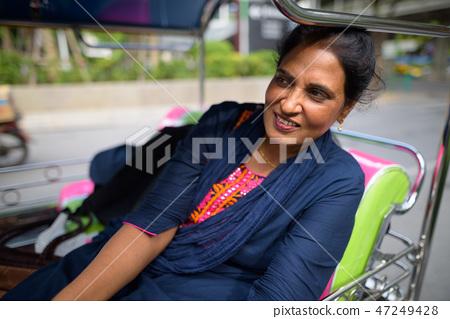 Mature beautiful Indian woman sitting in tuk tuk 47249428