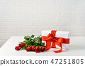 Gift box with bunch of roses on white table for Valentines Day 47251805
