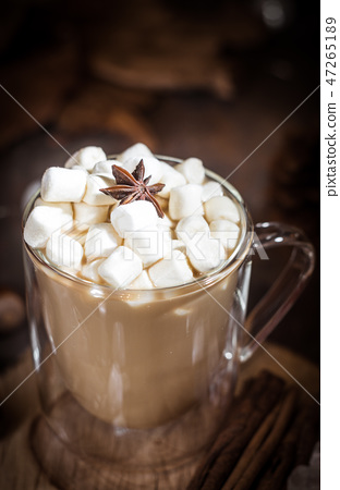Hot coffee with milk in transparent glass  47265189
