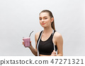 young happy woman with healthy diet shake drinking for sport and fitness. 47271321