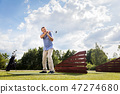 Active senior man hitting a golf ball. 47274680