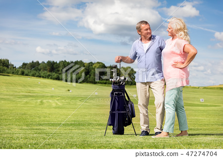 Senior couple enjoying golf game. 47274704