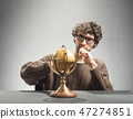 Young man looking at the artificial globe 47274851