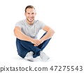 Man sitting with his legs crossed. Smiling guy. 47275543