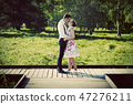 Young couple in love standing on wooden cross-roads 47276211