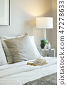 Glasses and book on bed in modern interior bedroom 47278633