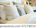 Closeup roll of pillows setting on comfortable bed 47278634