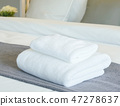 White towels on bed in modern bedroom interior 47278637