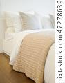 Comfortable bed in modern bedroom interior 47278639