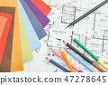 Architectural drawing with material on work table 47278645