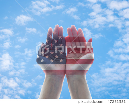 America flag pattern on woman hands with open palm 47281581