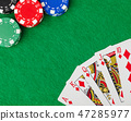 Casino chips and playing cards on green table 47285977