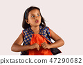 Pretty little girl looking excited, Pune  47290682