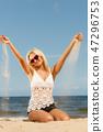 Pretty girl on beach. 47296753