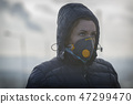 wearing a real anti-pollution, anti-smog face mask 47299470