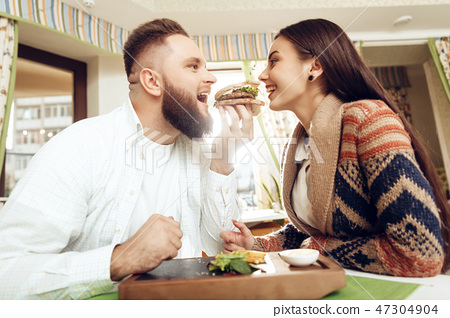 Happy man and woman having lunch in a restaurant 47304904