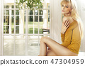 Blonde lady in the luxury house 47304959