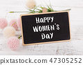 Small chalkboard for Women's day. Background with pink roses. 47305252