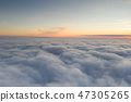 Sunset sky from the airplane window 47305265