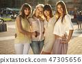 Delicate ladies in friendly hug 47305656