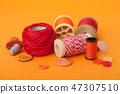 closeup of sewing set on orange background 47307510