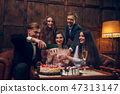 Cheerful friends celebrate birthday by drinking champagne and eating cake 47313147
