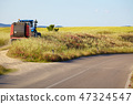 tractor in the fields of Tuscany 47324547