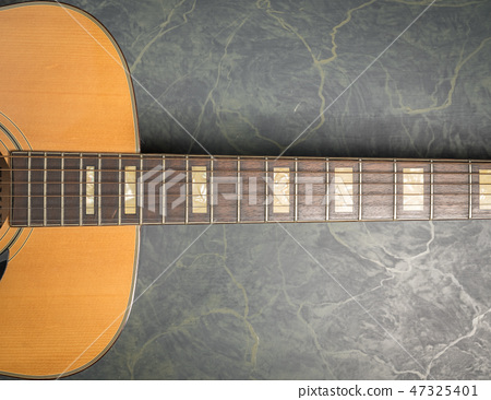 acoustic guitar from above on marble 47325401