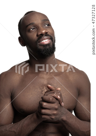 Close up portrait of a young naked african man indoors 47327128