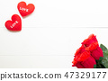 Present gift with red rose flower and heart shape 47329177
