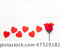 Present gift with red rose flower and heart shape 47329181