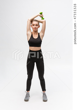 Young woman healthy lifestyle fitness with dumbbell. 47331328