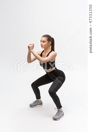 Exercise. Sports Woman In Fashion Sportswear Stretching Legs 47331350