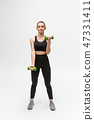 Portrait of Caucasian woman on white background wearing black fitness separate and excercising with 47331411