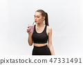 young happy woman with healthy diet shake drinking for sport and fitness. 47331491