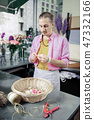 Attentive young florist working in modern studio 47332166