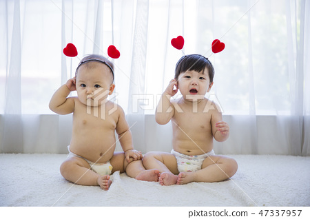 Little two cute babies photo. Baby wearing diaper in white bedroom. 163 47337957