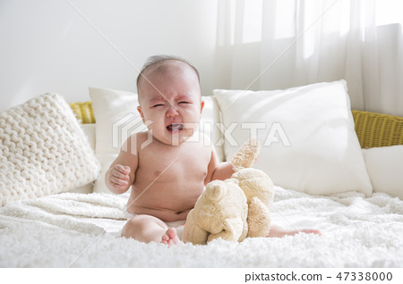 Little two cute babies photo. Baby wearing diaper in white bedroom. 169 47338000
