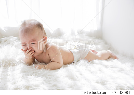 Little two cute babies photo. Baby wearing diaper in white bedroom. 011 47338001