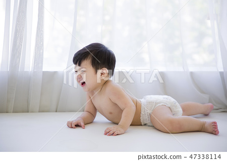 Little two cute babies photo. Baby wearing diaper in white bedroom. 190 47338114
