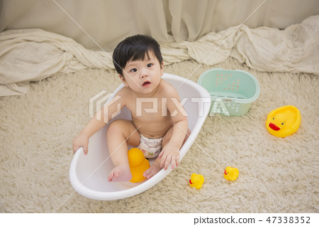 Little two cute babies photo. Baby wearing diaper in white bedroom. 153 47338352
