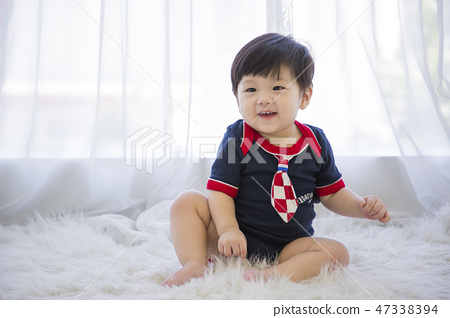 Little two cute babies photo. Baby wearing diaper in white bedroom. 129 47338394