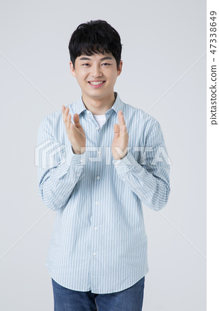 Portrait of a cheerful young man isolated photo 011 47338649