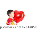 Boy  sibling with balloon  heart shape of love 47344859